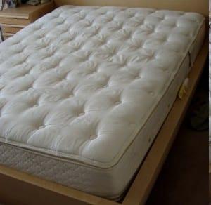 """A pillowtop mattress (U.S. size """"queen"""")"""