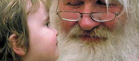 Santa Claus with young child